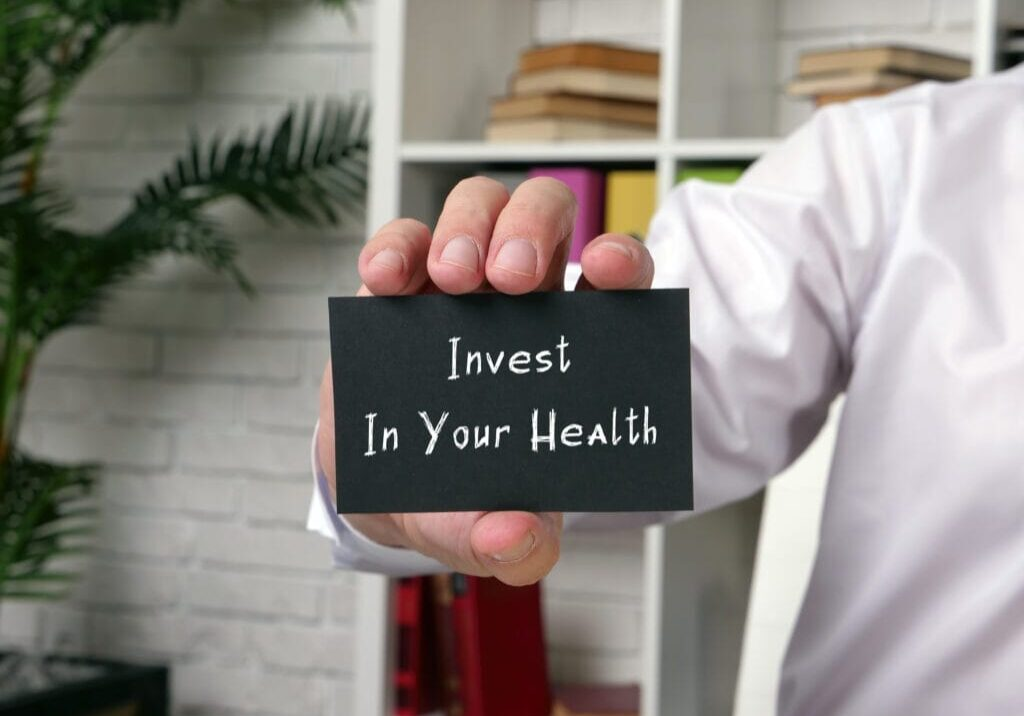 Juridical concept about Invest In Your Health with sign on the piece of paper.